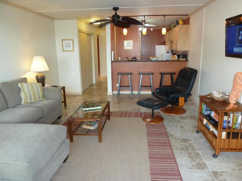 View of the living room into the kitchen - Kona Pacific Condominiums, Kailua-Kona, Hawaii - Kailua-Kona - rentals