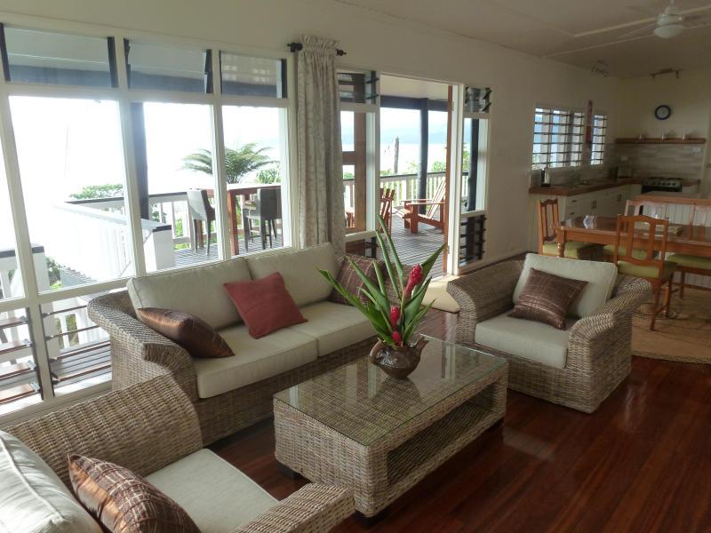 Living, dining room areas & kitchen provide a panoramic view of Savusavu Bay - Oceanfront Villa on Savusavu Bay - Savusavu - rentals