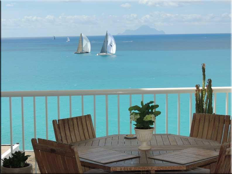 Dining table on Caribbean balcony with sailboats and Saba - Great Caribbean View - Saint Martin-Sint Maarten - rentals