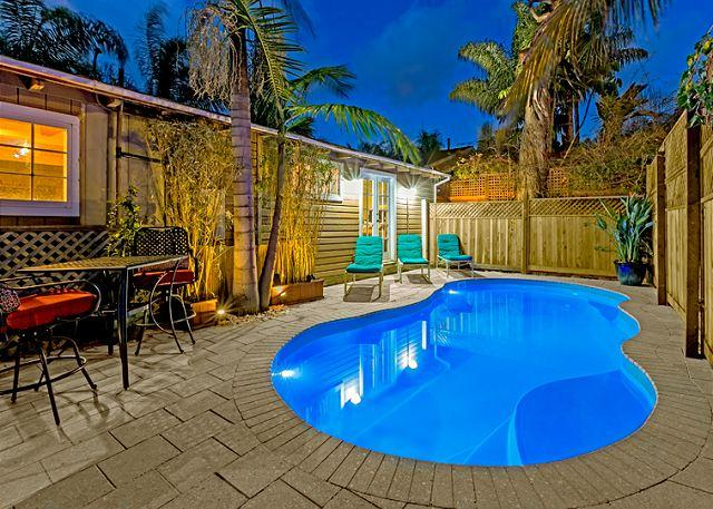 Brand new private pool with lounge seating, bistro table, and tropically landscaped surroundings - Poolside Paradise - steps to the beach with private pool and hot tub - La Jolla - rentals