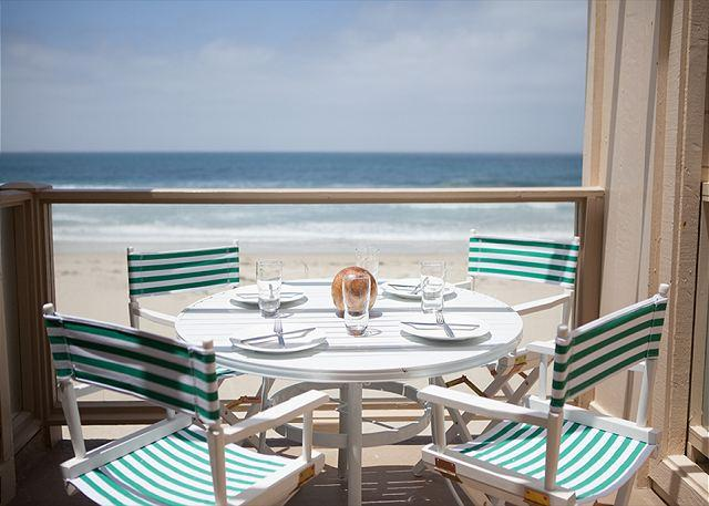 Enjoy al fresco dining on the oceanfront deck. - Oceanfront condo with stunning ocean, beach, and sunset views - San Diego - rentals