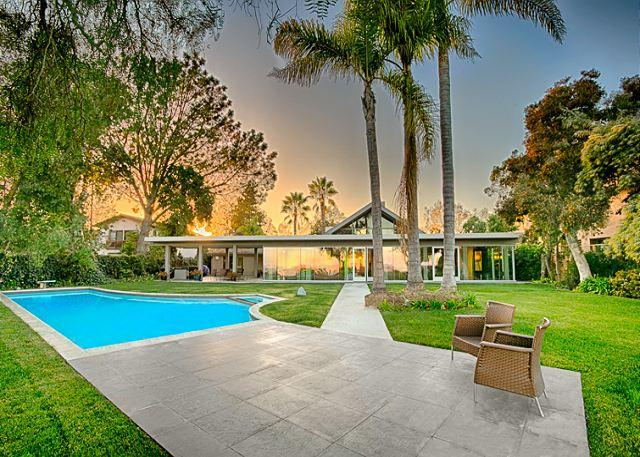 The peaceful back yard of this home has a large lawn,patio swimming pool. Diving board has been removed. - 17% OFF JAN DATES - Endless Vistas - private pool, elegance and tranquility - La Jolla - rentals