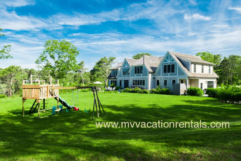 Yard and Children's Play Area - MORAA - Designer Luxury Home Overlooking Farm Neck Golf Course, Waterviews, Central A/C, WiFi,  Short Bike Ride to State Beach or Oak Bluffs Town Center. - Oak Bluffs - rentals