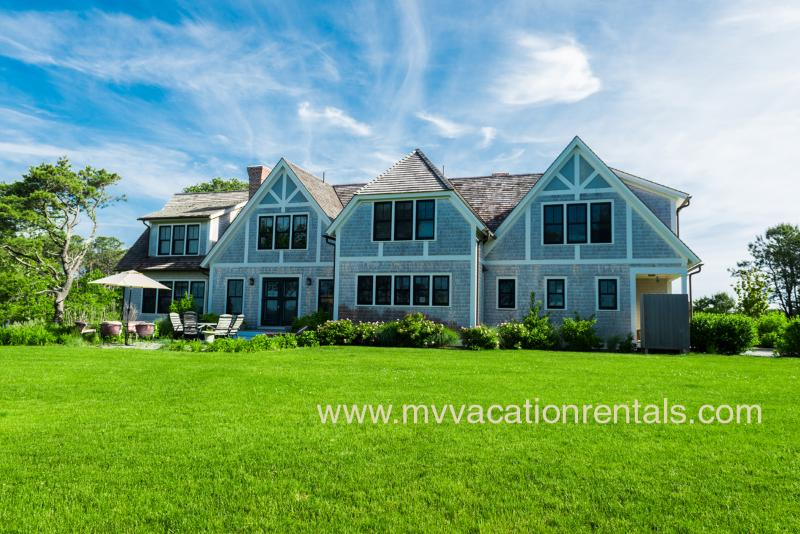 Yard, Patio and Back of House - MORAA - Luxury Home Overlooking Farm Neck Golf Course with Waterviews, Ferry Tickets,  Short Bike Ride to State Beach or Oak Bluffs Town Center. - Oak Bluffs - rentals