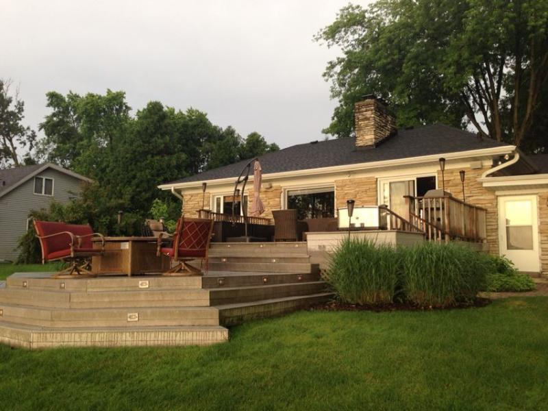 Outside with a large terraced deck - Lac La Belle Lake, Oconomowoc Cottage Retreat - Oconomowoc - rentals