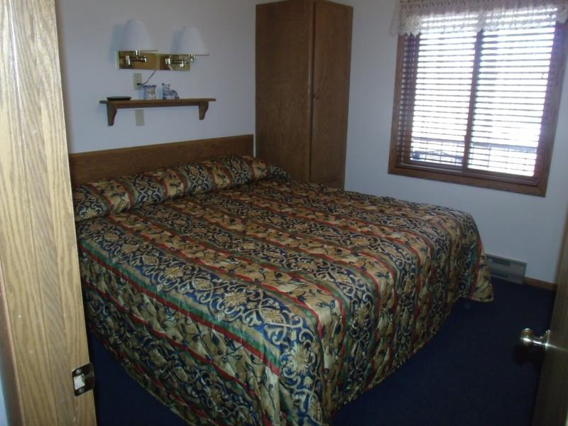 KING SIZE BED IN PRIVATE BEDROOM - MOORE'S AFFORDABLE GETAWAY At The Landmark Resort - Egg Harbor - rentals