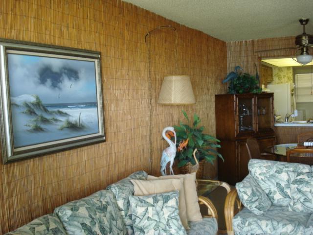 Living room looking toward kitchen - Sea Oats Condominiums - Cocoa Beach - rentals