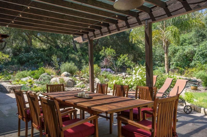 The perfect place to enjoy the opulent backyard is at the covered outdoor dining table for 8. There's room for a few more in the lounge chairs. - A large creek side retreat with amazing outdoor living space - Magical Canyon Retreat - Santa Barbara - rentals