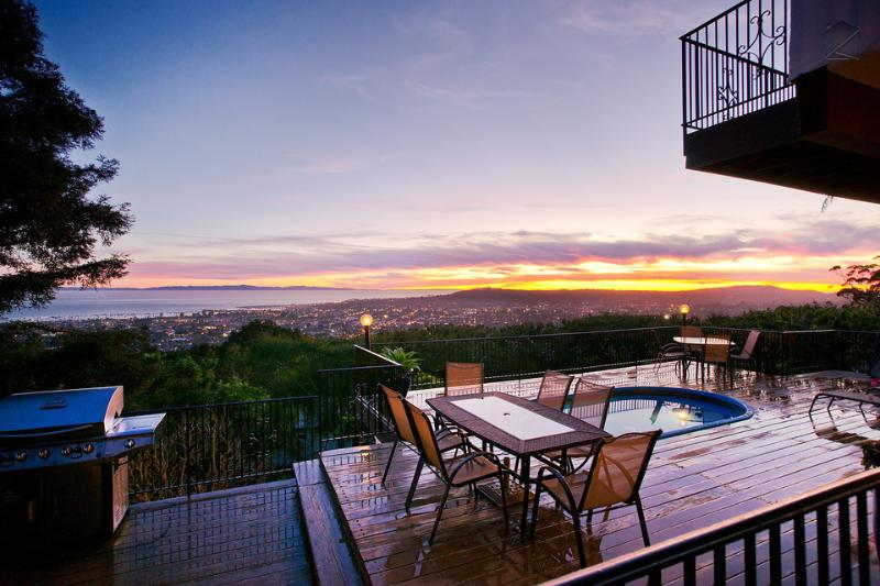 Set your alarm for sunset because you'll want to make sure you're home in time for the show. The deck has a dining table, gas grill, and hot tub. - Large Riviera home with A/C & ocean view deck with hot tub - Sunset Heights - Santa Barbara - rentals