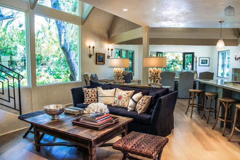 The first floor great room has great light, an open layout, and plenty of features like a gas fireplace, 46-inch flat screen TV, recessed lighting, and hardwood floors. - Charming creekside home near Montecito Upper Village - Quiet Oaks - Montecito - rentals
