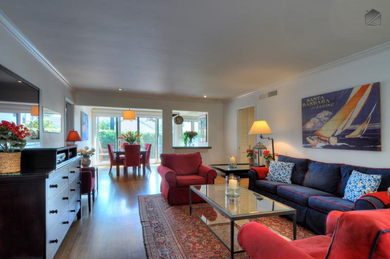Watch movies on the flatscreen TV in this comfortable living room with plenty of plush seating, hardwood floors, and nice artwork. - Pristine, charming West Beach family home  - Juniper Cottage - Santa Barbara - rentals