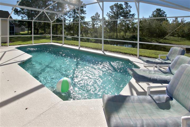South facing Pool Deck and Conservation Area beyond. - LUXURY SINGLE STOREY POOL HOME WITH LAKE VIEW - Davenport - rentals