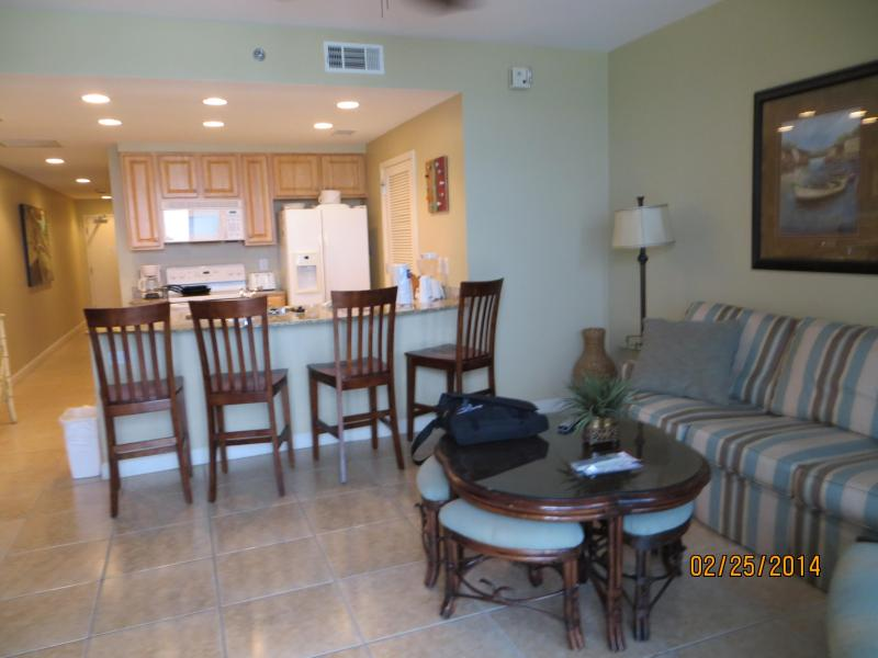 A view of the living room from the sliding glass doors. - Splash  One BedroomCondo with Daily Beach Service - Panama City Beach - rentals
