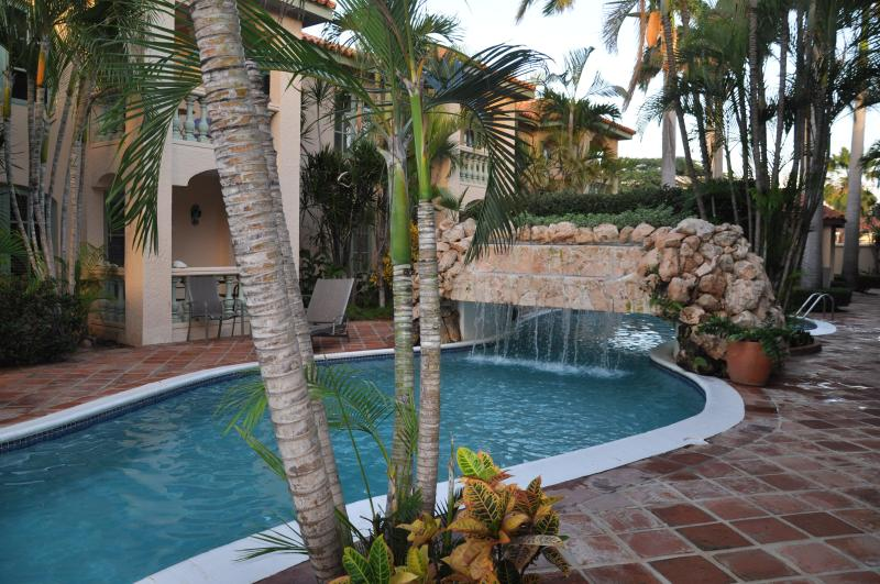 LARGE LAP POOL AND WATERFALLS - Ground Floor Unit Beside Pool - Palm/Eagle Beach - rentals
