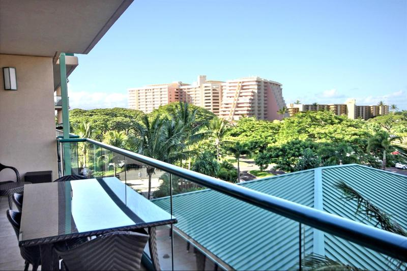 The view off the lanai looking to your left. Notice the large out door dining table with seating for four(4). - Honua Kai #HKK-424 Kaanapali, Maui, Hawaii - Kaanapali - rentals