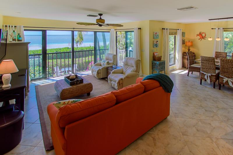 Open the sliders and let the ocean breezes into the expanded main living area - Sea Dreams: Luxury Ocean and Beach Front Townhome - Captiva Island - rentals
