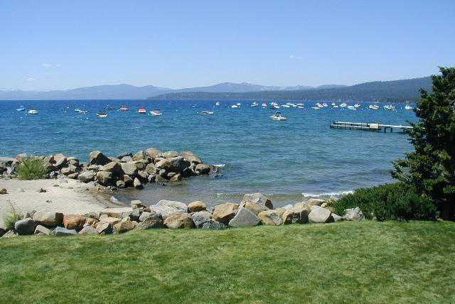 View of the private beach from grassy lawn - Lakeside Getaway in Tahoe Vista - Tahoe Vista - rentals