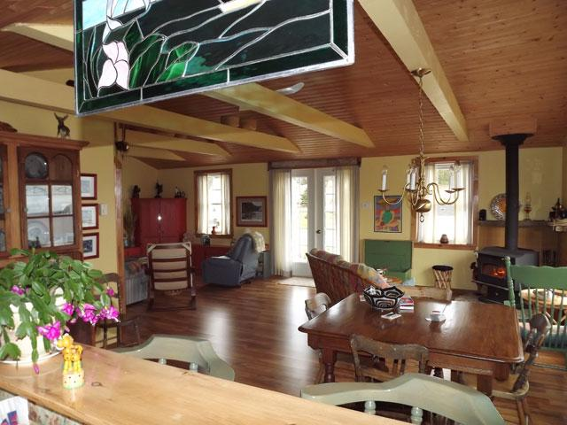 Open Living Room with a fireplace facing the Ocean - Little Wild Cove Cottage - Twillingate - rentals