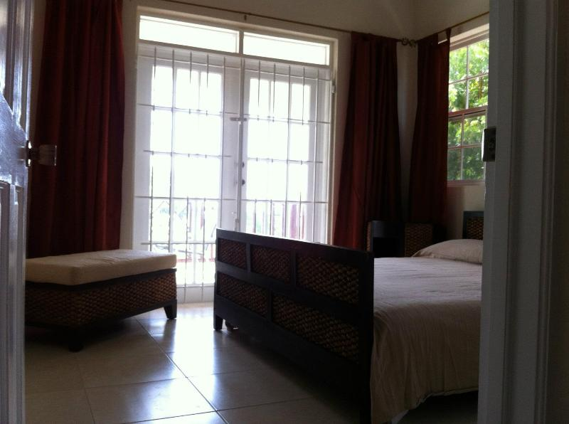 Bedroom with doors to the balcony - Ist Floor one bed apartment at Chelsea Villas - Maxwell - rentals