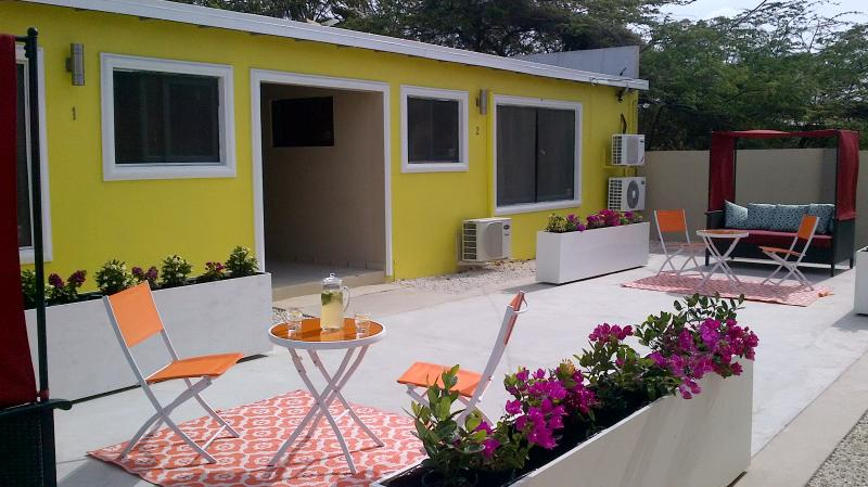 cozy little private area for morning coffee or evening cappuccino. - Aruba Palm Beach Suites - 5 mins walk to beach! - Sierra Nevada - rentals