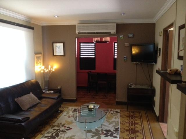 Living Room Area (TV with DishNwtrk) and Dining Room Area - 2 BR Apartment in Historic Miramar, walk to beach - San Juan - rentals