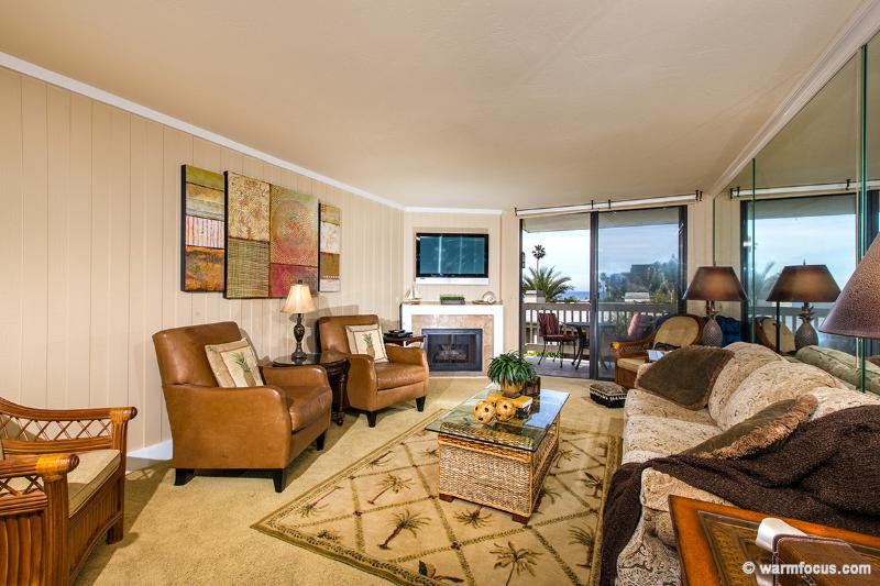 Your warm and inviting living room is a wonderful place to relax after a day in the sun. - Villa del Mar~Straight-on Ocean Views from Inside! - Oceanside - rentals