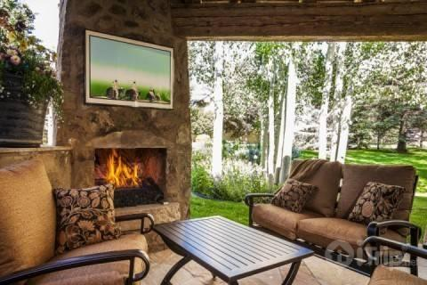 Enjoy comfortable outdoor living year round by the cozy patio fireplace of this gorgeous Arrowhead home. - Windermere Circle - Edwards - rentals