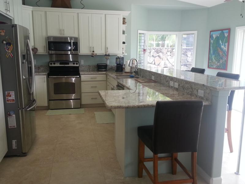 Huge Kitchen with full size appliances and access to pool and lanai - KAILUA DREAMS-MAKAI:  NEW, LUXURIOUS AND SPACIOUS - Kailua - rentals