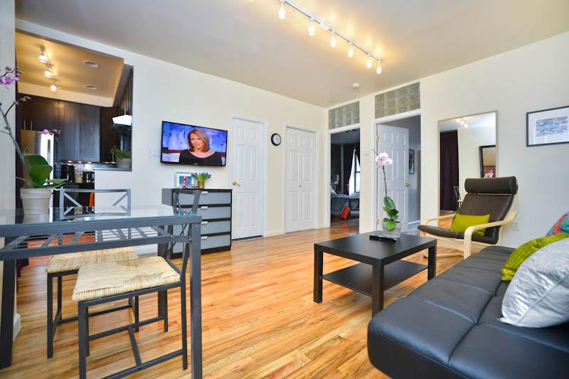 Living area with hardwood floors and contemporary furnishings - **JAMES** Upper East Side Contemporary  2 Bedroom! - New York City - rentals