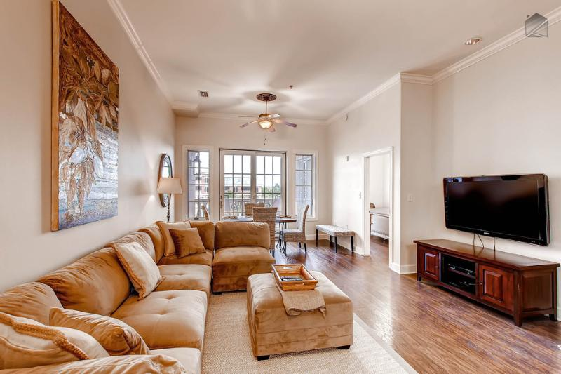 The spacious living room has a huge flatscreen TV and a sectional couch that can comfortably fit the whole clan. - Stylish, well-appointed Seacrest Beach condo, 2 King beds, near Lagoon Pool - The Newcastle - Seacrest Beach - rentals