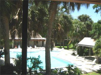 "Screened in lanai overlooking the ""quiet pool"" area and the lake - Paradise Lakes (Clothing Optional): B-2 (ADULTS ON - Tampa - rentals"
