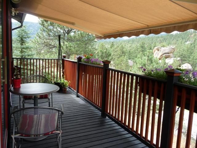 """Old Man Mountain studio"" relax on the covered deck. - Bunkhouse at Old Man Mountain Studios - location! - Estes Park - rentals"