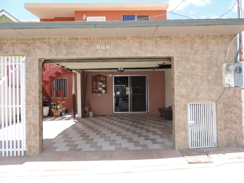 Front of House with Garage Door Open - Ensenada Bottom Floor House in Quiet Neighborhood - Ensenada - rentals