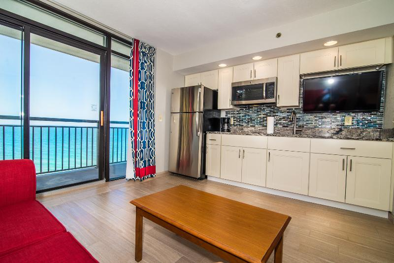 Enjoy the open kitchen/living room as you look out at the ocean and tropical pool area below. - *New* Updated oceanfront condo with 5 pools - North Myrtle Beach - rentals