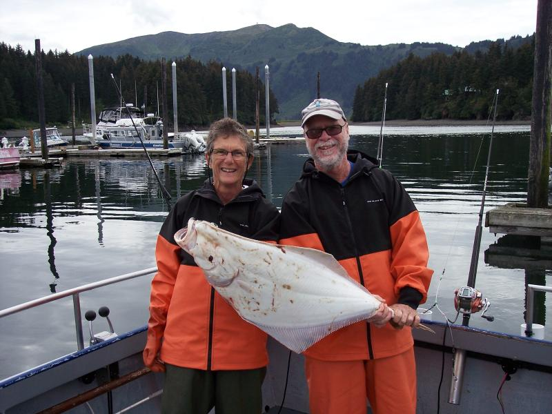 Hosts Brent & Raewyn with freshly caught halibut - Seldovia, Alaska B&B - Seldovia - rentals