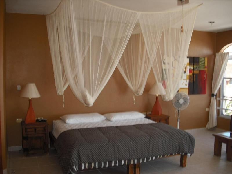 Master bedroom, king bed, private bath, A/C, balcony with ocean view - Beach house, in town, 4 BR, steps to the beach - Puerto Morelos - rentals