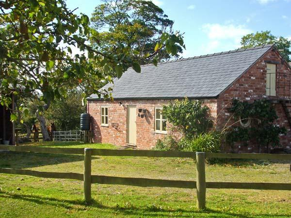 LITTLE PENTRE BARN, character holiday cottage, with pool near Overton-on-Dee - Image 1 - Wrexham - rentals