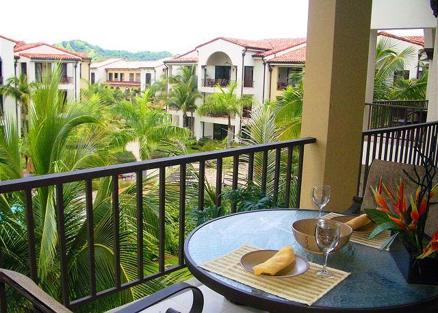 Enjoy dining on the balcony overlooking the pool and beautilful grounds of Pacifico. - Pacifico L1213 - Beautiful One Bedroom Pacifico Condo on third floor - Playas del Coco - rentals