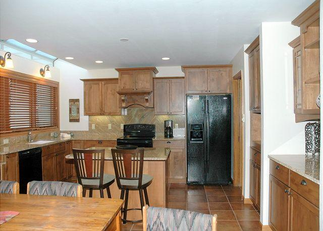 Open Kitchen and Dining Area - Remodeled Ski in Ski out two bedroom at the full service Iron Horse Resort. - Winter Park - rentals