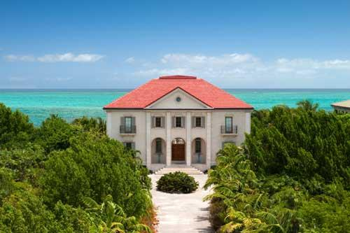 An aerial photograph of Beach Villa Paprika, Providenciales (Provo), Turks and Caicos Islands, BWI. - Beach Villa Paprika--on famous Grace Bay beach - Providenciales - rentals