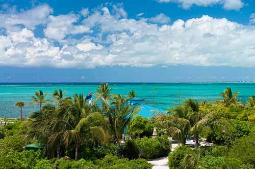 A photograph of sugar-white Grace Bay Beach in front of Conch Pearl Villa, Providenciales (Provo), Turks and Caicos Islands, BWI. - Conch Pearl - Beachfront Villa with Hot Tub - Providenciales - rentals