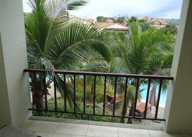 Look down on the Lazy River Pool from the balcony. - Pacifico L108 -New Pacifico 3 Bedroom, 2 Bath Custom Decorated Condo - Playas del Coco - rentals