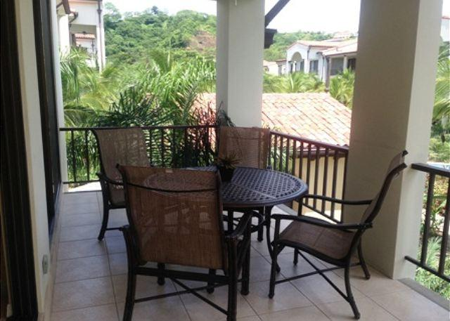 Enjoy outside dinning with a pool and garden view. - Pacifico L105 - 3 Bedroom, 2 Bath Custom Decorated Condo - Playas del Coco - rentals