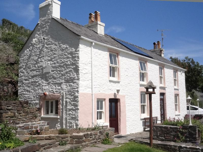 The cottage viewed from the side garden - Seaside cottage overlooking the beach at Amroth. - Amroth - rentals