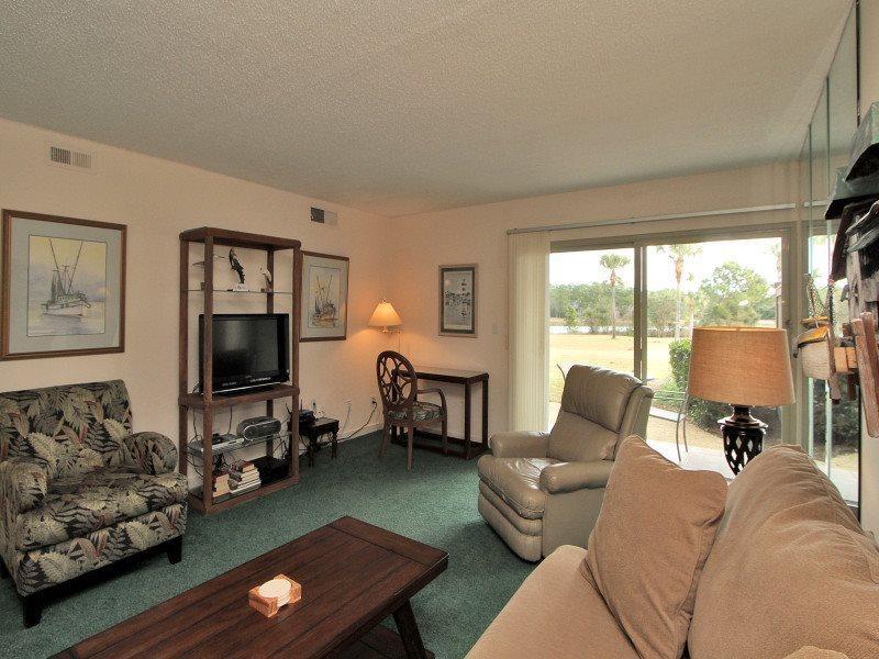 Living Room with Patio Access at 1723 Bluff Villa - 1723 Bluff Villa - Sea Pines - rentals