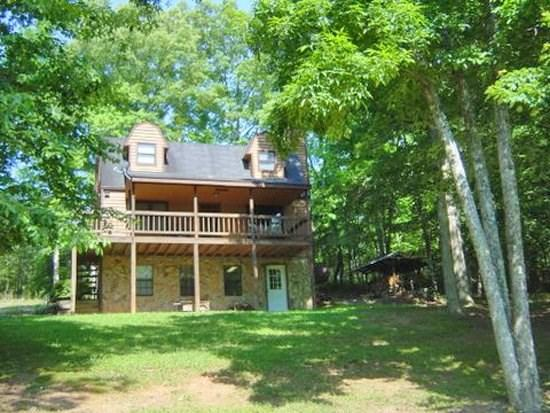 KINGDOM CABIN #1*TOTALLY SECLUDED~4 BR~3BA~PING PONG~POND~CHARCOAL GRILL~SAT TV~WiFi~WOOD BURNING FIREPLACE~PORCH SWING~PLAY AREA FOR CHILDREN~ONLY $99/NIGHT! - Image 1 - Blue Ridge - rentals