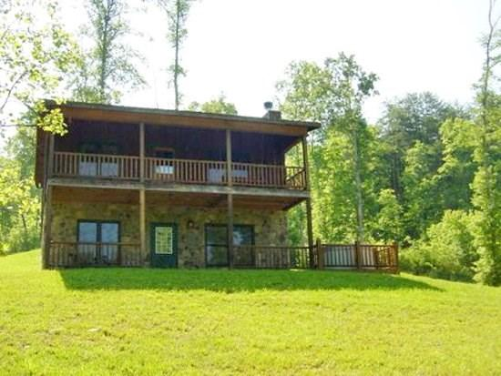 KINGDOM CABIN #2*TOTALLY SECLUDED~3BR~2 BA~CABIN WITH CREEK~HOT TUB~CHARCOAL GRILL~FIREPLACE~FIRE PIT~PET FRIENDLY~SLEEPS 8~ONLY $99/NIGHT! - Image 1 - Blue Ridge - rentals