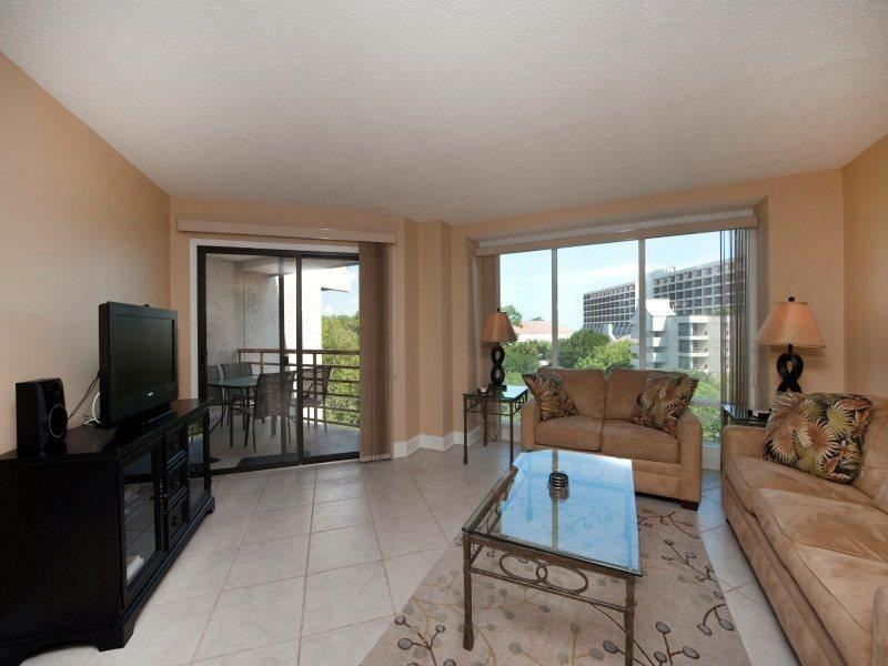 Living Room with Balcony Access and Flat Screen at 2518 Villamare - 2518 Villamare - Palmetto Dunes - rentals