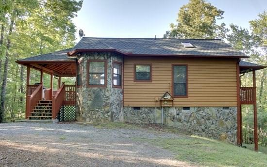 POWELL`S DEN- NEW TO THE PROGRAM! 2BR/2BA COMPLETELY SECLUDED CABIN WITH INDOOR HOT TUB, GAS LOG FIREPLACES IN LIVING ROOM AND MASTER BEDROOM, BEAUTIFUL MOUNTAIN VIEW, GAS GRILL, ONLY $99 A NIGHT! - Image 1 - Blue Ridge - rentals