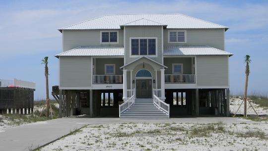 "Front of home, large concrete driveway with plenty of parking. - ""Crews Quarters"" Luxury Gulf Front Home w/pvt pool - Gulf Shores - rentals"